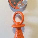 Orange dummy shaped rubber teething chew